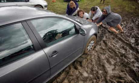 Festival Goers Depart From A Muddy Glastonbury