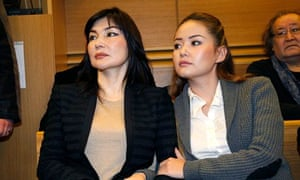 Mukhtar Ablyazov's wife and daughter Alma and Madina Ablyazov wait in a courtroom