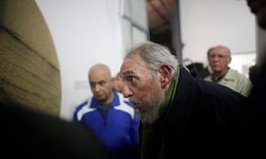Fidel Castro looks at an artwork during the inauguration of a gallery in Havana, Cuba