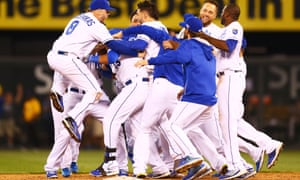 The Kansas City Royals celebrate their miraculous 9-8 win over the Oakland Athletics in the 12th inning of their American League Wild Card game at Kauffman Stadium.