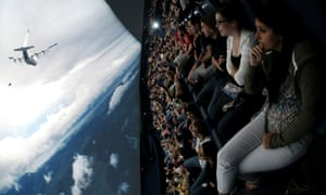 An audience in New Jersey watches The Dark Knight Rises in IMAX.