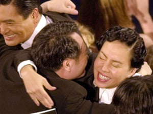 Director Ang Lee hugs Jasmine Chow wife of actor Chow Yun-Fat, left, after hearing he won the Oscar for best foreign language film for Crouching Tiger, Hidden Dragon in 2001.