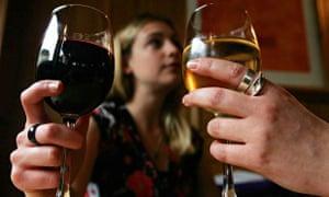 Women drinking wine in bar