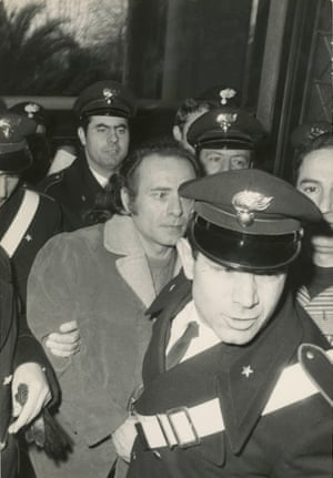 Police escort Piazza Fontana bombing accused Pietro Valpreda to court, Rome, 1972.