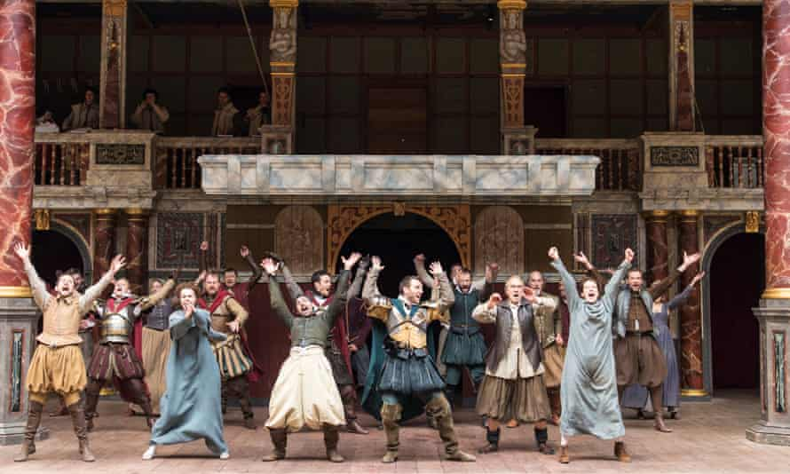 Actors perform a traditional jig at the end of Julius Caesar at the Globe theatre in London