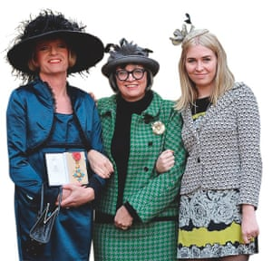 Grayson Perry with his wife Phillipa and daughter Florence, receiving an OBE in 2014