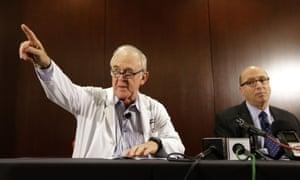 Dr. Edward Goodman, left, epidemiologist at Texas Health Presbyterian Hospital Dallas, at a news conference.