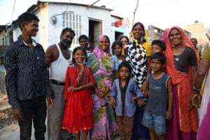 Umarwal poses with members of her family and her neighbour, Mahesh Kirar