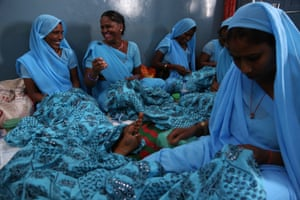 Umarwal and other women stitch skirts at the Nai Disha centre