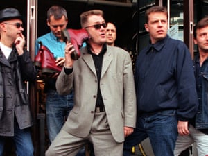 Madness in 1999, with Cathal Smyth to the left and front of Suggs.