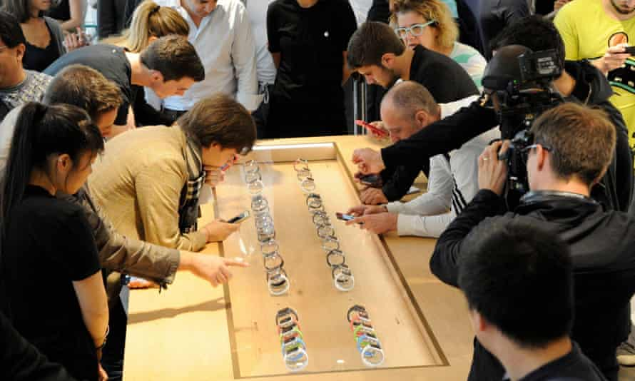 People look at the Apple Watch at the Colette store, Paris, France in a one-day showcast during Paris Fashion Week.