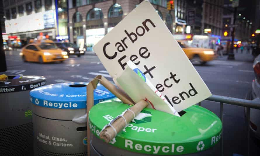 "A sign that had been carried during the ""People's Climate March"" is discarded into the trash after the march in the Manhattan borough of New York"