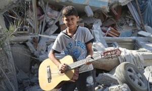 """Mahmoud, 10: """"I like to play the guitar because music takes you away from life."""""""