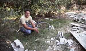 """""""I was bought this bike for my 15th birthday. I used to ride it to market to buy food for the family."""" Mussab's sister, Duaa, was killed in a rocket attack. His brother is calling his unborn daughter Duaa in her memory."""