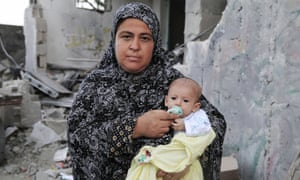 """Ghada: """"The only precious thing I have left is my baby. As soon as my house was hit, she was the first and only thing I took."""" Ghada now lives in a school. She desperately needs food for herself  and milk and clothes for the baby."""