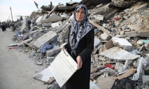"""Nadia: """"This is a piece of the bed I bought my son and his bride to be. They were due to marry in a few days."""" Thirteen members of Nadia's family were killed in the conflict. She and her family now sleep on the roof of her brother's home."""