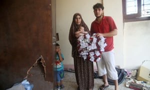 """Rodian and Mohammed: """"This wedding gift: what can I say? It's ruined. All of our memories are gone."""" Rodian and Mohammed took refuge at his father's apartment but lack kitchen equipment, water and food."""