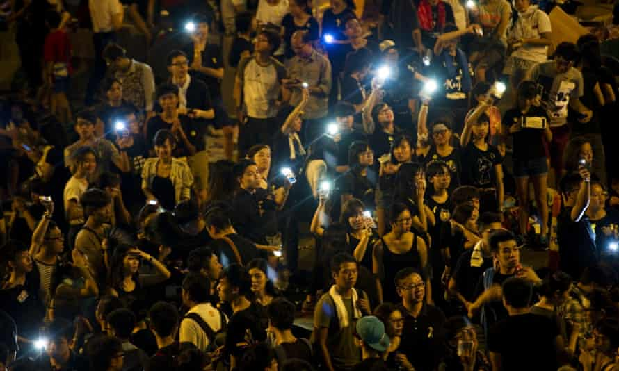 Demonstrators hold up their mobile phones to form a 'sea of lights' in Admirality, as part of a pro-democracy sit-in known as 'Occupy Central', blocking traffic on Gloucester Road, an otherwise busy multi-lane thoroughfare in Hong Kong, on October 1, 2014.