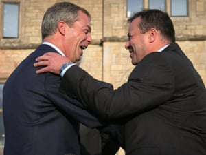 The Ukip leader Nigel Farage, left, and Arron Banks embrace after the latter's pledge to give the party £1m.
