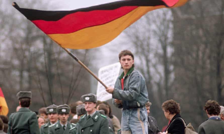 Man Waving West German Flag