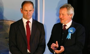 Conservative candidate Giles Watling applauds as Ukip's Douglas Carswell is named the winner in the Clacton byelection.