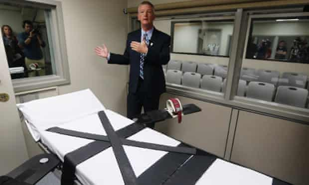 Department of Corrections official Scott Crow talks behind the newly renovated death chamber at the Oklahoma State Penitentiary during a media tour of the facility in McAlester.