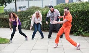 Zombies in training: volunteers prepare their moves.