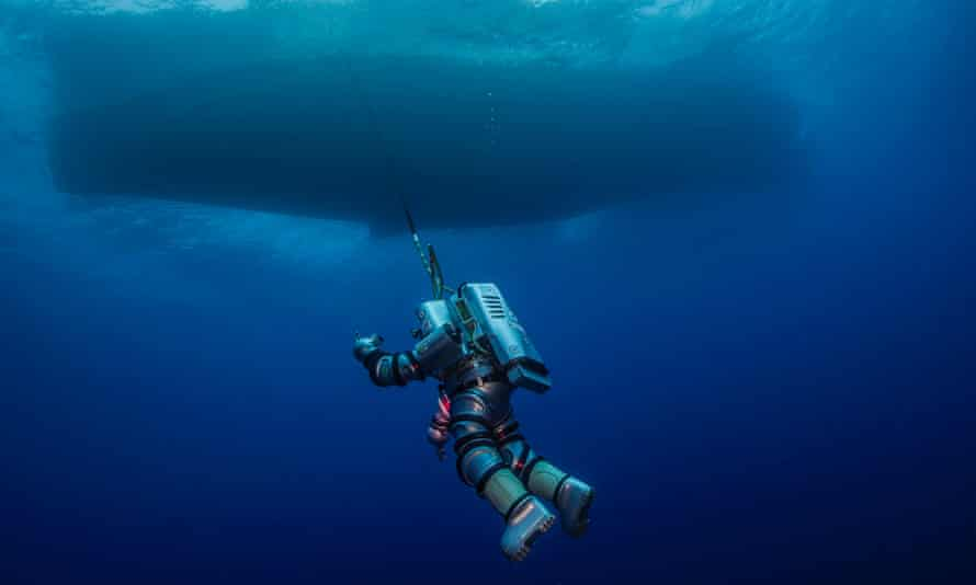 A diver wearing a robotic exosuit explores the site of the wreck called the Titanic of the ancient world