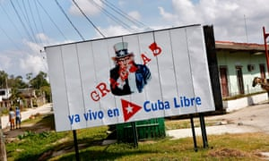 A billboard shows Uncle Sam and reads: 'No Thank You, I already live in a Free Cuba'.