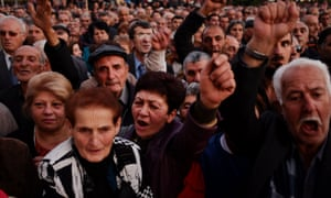Protesters shout during an opposition rally in Yerevan on Friday to protest an impending constitutional reforms that they fear could be abused by the incumbent president.