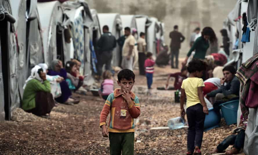 Homeless: a Kurdish refugee camp in the Turkish town of Suruc yesterday. Around 300,000 people have fled Kobane following its assault by Islamic State jihadis.