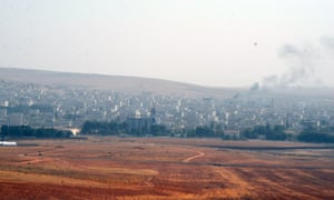 Smoke rises from Kobani as reports emerge that Isis terrorists are defeating the Kurdish militia defending the city.