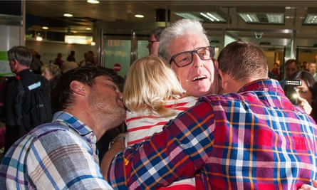 Ray Coles is greeted by his family at Gatwick airport after being released from jail in Morocco
