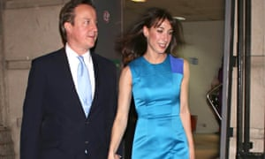 David and Samantha Cameron arriving at the Conservative party's black and white ball in central London.