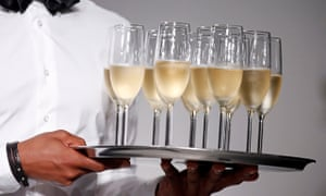 File photo of a tray of champagne flutes at the end of a ready-to-wear fashion show in Paris