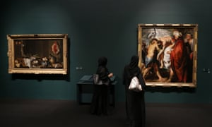 (FILES) - A file picture taken on April 21, 2013 shows Emirati visitors walking past paintings that are part of 130 artworks featured at the first large-scale presentation of the permanent collection of Abu Dhabi's planned Louvre Museum, at a venue on the Saddiyat Island where the museum will be built off the Emirati capital. Masterpieces of Leonardo da Vinci, Vincent Van Gogh, Claude Monet, Henri Matisse and Andy Warhol are among 300 works which will be on loan from 13 French museums for the opening of the The Louvre Abu Dhabi museum, the Emirates announced on October 11, 2014. AFP PHOTO/KARIM SAHIBKARIM SAHIB/AFP/Getty Images