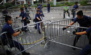 Police remove barricades erected by pro-democracy protesters at the main protest site.