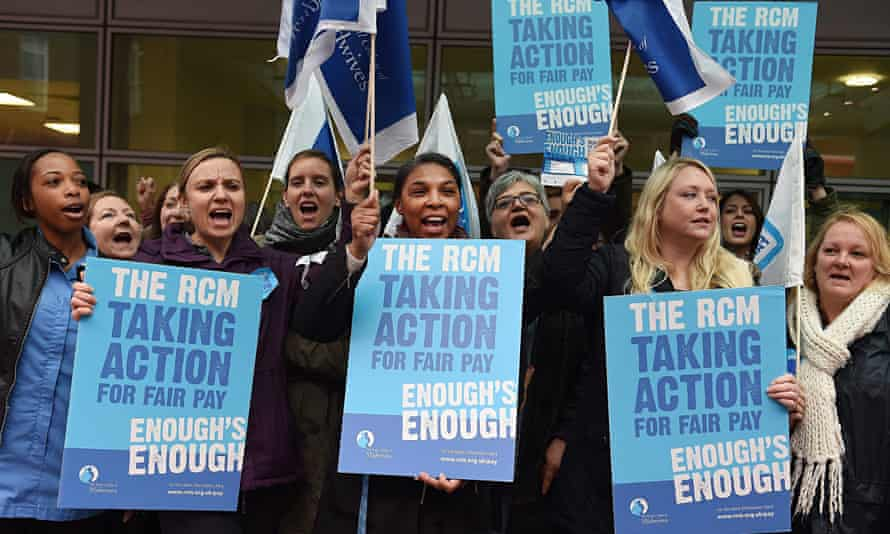 Striking midwives picket a hospital in London
