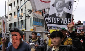 An an anti-Abe government rally in Tokyo. Abe's recent cabinet reshuffle has raised fears that Japan is veering sharply to the right.