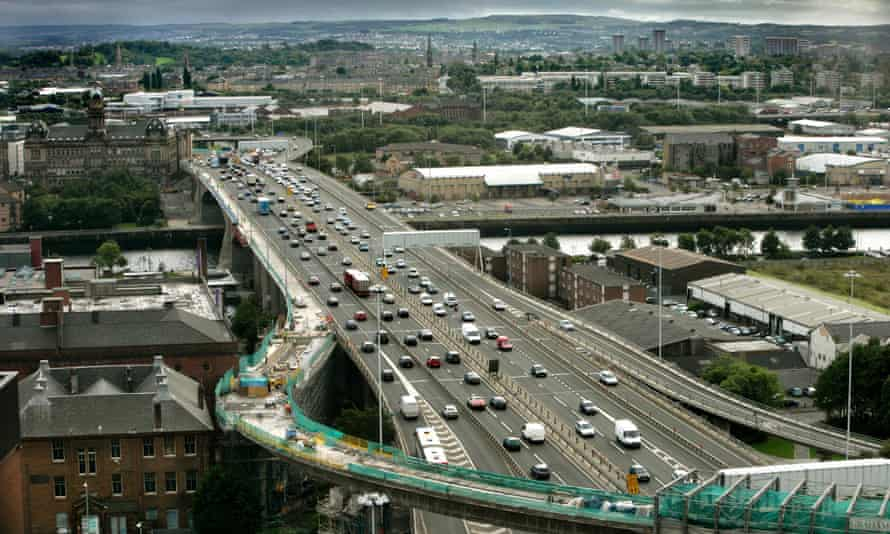 The M8 motorway's Kingston bridge crosses the Clyde and slices its way through Glasgow city centre soon to controversialy connect with the M74