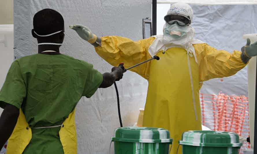 A health worker is decontaminated