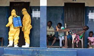 Health workers disinfect a home