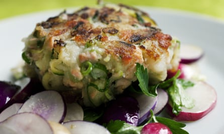 Nigel Slater's courgette and salmon cake recipe on a round plate.