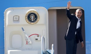 President Barack Obama waves as he boards Air Force One
