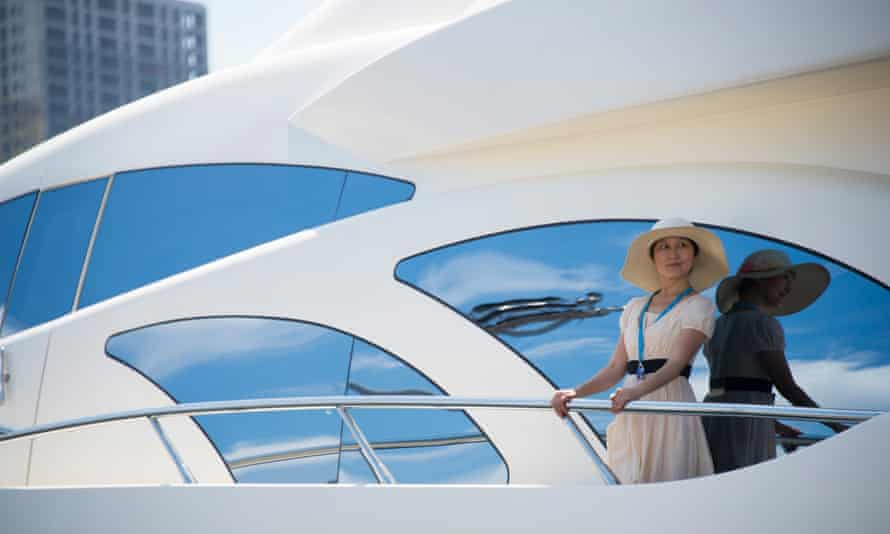 A model on a luxury yacht at a boat show in the port of Dalian.