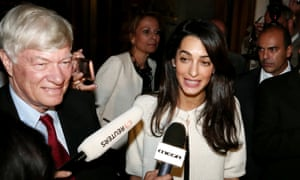 Lawyer Amal Alamuddin Clooney with lawyer Geoffrey Robertson talking to reporters outside the Hotel Grande Bretagne entrance.