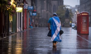 A dejected 'Yes' supporter in Edinburgh heading home after Scotland voted in September to reject independence. Following the vote, MPs are today discussing plans for further devolution for Scotland, and for England too.