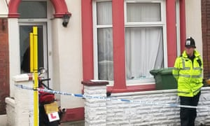 Police stand outside a house in Portsmouth, Hampshire, after six people were arrested on suspicion of terrorism offences following an operation by the South East Counter Terrorism Unit.
