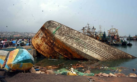 Cyclone Hudhud, a capsized boat in Visakhapatnam