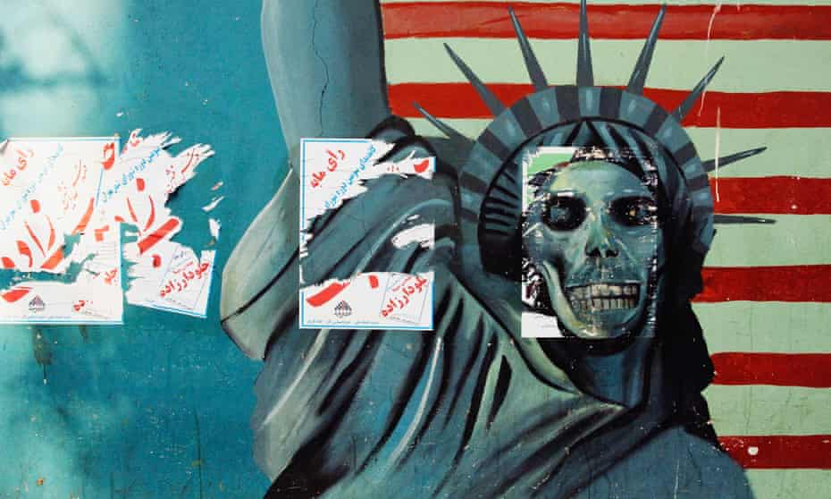 Anti-American murals adorn the former US in  Tehran, Iran.